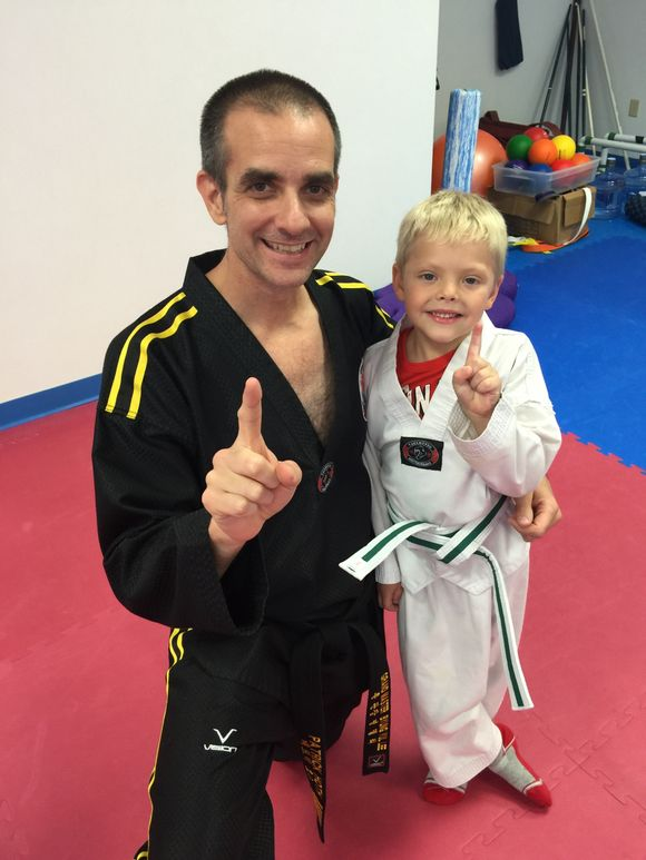 Noah gets his Lil Dragons Green Belt!  St Michael location